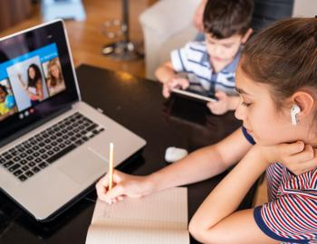 students learning from home on laptop
