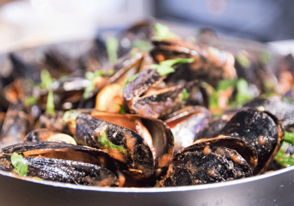 mussels in a sauce with garnish