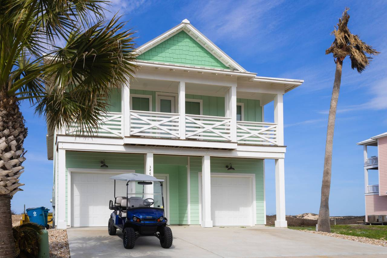 A Port Aransas vacation rental with a golf cart